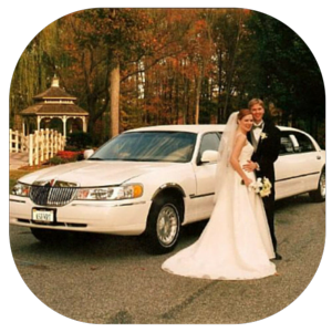 Newlyweds in Front of Limo