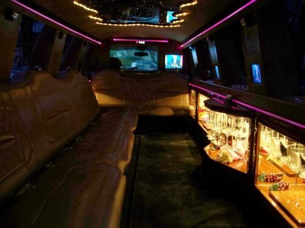[Image: Enjoy your journey in style with a limo with lights and a bar. ]
